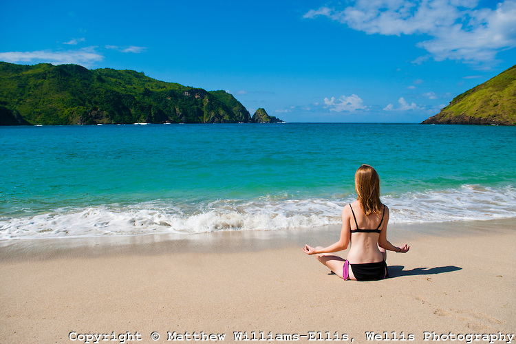 Woman Meditating at Mawun Beach, a Tropical Paradise in South Lombok, Indonesia